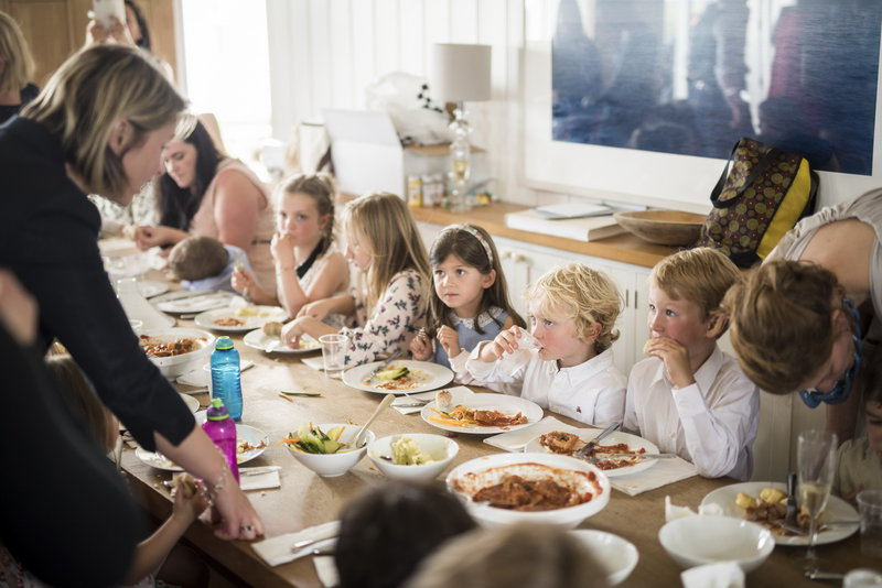 children-gathered-around-Crear-lounge-table-having-kids-meal.jpg