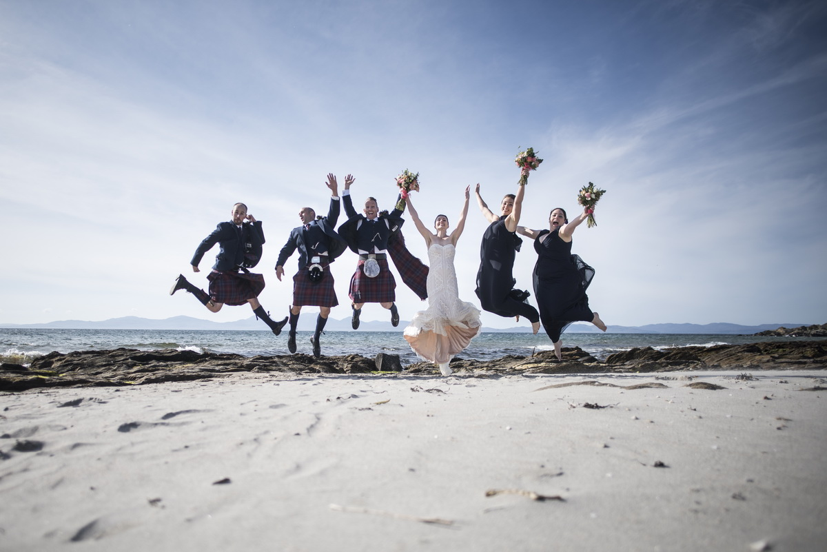 small-wedding-beach-bridal-couple-guests-jumping-destination-wedding-scottish-west-coast.jpg
